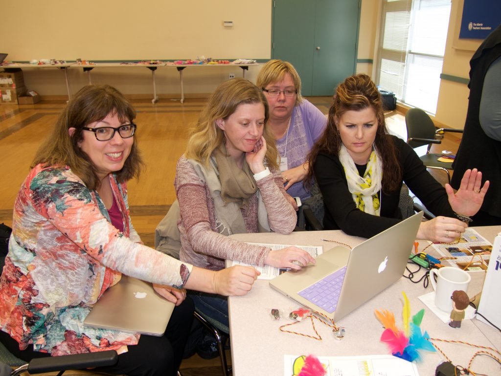 Sylvia Martinez (far left) works with teachers in Australian workshop